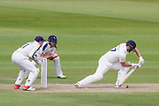 Ryan Pringle (Durham County Cricket Club)plays safe off the bowling of Adil U Rashid (Yorkshire CCC). Wicket keeper Jonathan M Bairstow  fields in close during the LV County Championship Div 1 match between Durham County Cricket Club and Yorkshire County Cricket Club at the Emirates Durham ICG Ground, Chester-le-Street, United Kingdom on 30 June 2015. Photo by George Ledger.