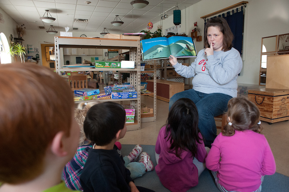 Dana Parsely shushes her assembled class at the Ohio University Childhood Development center during reading time. © Ohio University / Photo by Ross Brinkerhoff