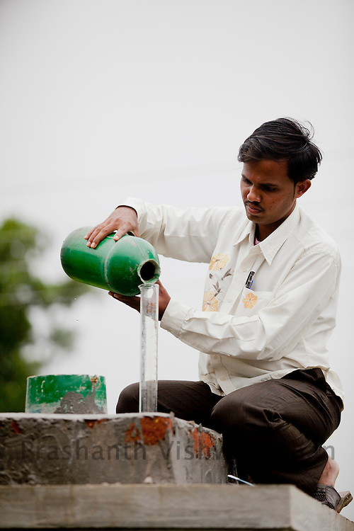 Village Dadapur, Warora Block, Dist. Chandrapur. .27 year old Amol Dongre checks a rain gauge for measuring rainfall, for water budgeting and water security under WASH Bio village project. Bio Village is a part of the over all obejective of the Water Hygiene and Sanitation project ( WASH). UNICEF partners with the State nodal Department, Water Supply and Sanitation Department under the State Government and District level TSC, Divisions, Key resource Centres and NGOs. Special initiatives have been undertaken in the State such as Bio-Village Project in IDPs, WASH Compliance in Schools, Multiple Use Water Services project (MWUS), Sanitary Napkin production and promotion of menstrual hygiene, Risk based rapid assessment of water quality as per JMP manual and NGP concurrent monitoring.UNICEF India/2012/Vishwanathan