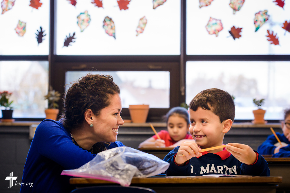 Principal Julieane Cook spends time with students while visiting classrooms at St. Martini Lutheran School on Tuesday, Nov. 14, 2017, in Milwaukee. LCMS Communications/Erik M. Lunsford