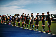 The Black Sticks walk out for the national anthem. Black Sticks Men vs Korea test series, Lloyd Elsmore Hockey Stadium, Auckland, New Zealand. 16 March 2016. Photo: Anthony Au-Yeung / www.photosport.nz