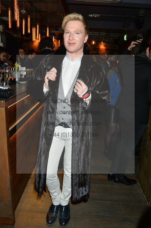 HENRY CONWAY at the launch of Korean restaurant Jinjuu with chef Judy Joo at 15 Kingley Street, London on 22nd January 2015.