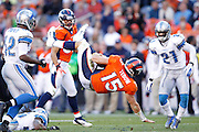 DENVER, CO - OCTOBER 30: Tim Tebow #15 of the Denver Broncos gets upended by Louis Delmas #26 of the Detroit Lions at Sports Authority Field at Mile High on October 30, 2011 in Denver, Colorado. The Lions won 45-10. (Photo by Joe Robbins)