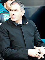 Football - 2017 / 2018 Premier League - Swansea City vs. Brighton & Hove Albion<br /> <br /> Swansea City manager Paul Clement looks nervous before the match on the touchline, at The Liberty Stadium.<br /> <br /> COLORSPORT/WINSTON BYNORTH