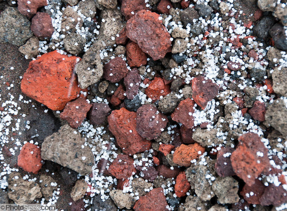 Graupel (snow pellets) fall on volcanic rocks in Cotopaxi National Park (Spanish: Parque Nacional Cotopaxi), a protected area in Ecuador in the Cotopaxi Province, Napo Province and Pichincha Province. Cotopaxi is a stratovolcano in the Andes Mountains, located about 75 kilometers (50 miles) south of Quito, Ecuador, South America. It is the second highest summit in Ecuador, reaching a height of 5,897 m (19,347 ft). Cotopaxi has an almost symmetrical cone that rises from a highland plain of about 3,800 metres (12,500 ft), with a width at its base of about 23 kilometers (14 mi). It has one of the few equatorial glaciers in the world, which starts at the height of 5,000 meters (16,400 feet). The mountain is clearly visible on the skyline from Quito. It is part of the chain of volcanoes around the Pacific plate known as the Pacific Ring of Fire.