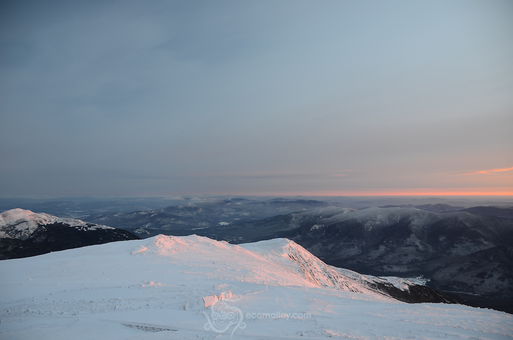 Sunlight touches the summits at sunrise.