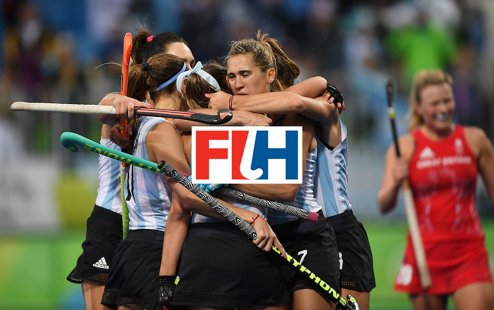 Argentina's Florencia Habif (16) celebrates scoring a goal with teammates during the women's field hockey Britain vs Argentina match of the Rio 2016 Olympics Games at the Olympic Hockey Centre in Rio de Janeiro on August, 10 2016. / AFP / MANAN VATSYAYANA        (Photo credit should read MANAN VATSYAYANA/AFP/Getty Images)