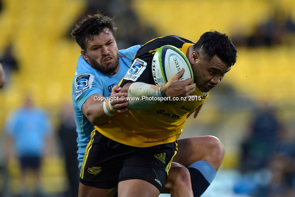 Hurricanes' hooker Motu Matu'u is tackled by Waratahs' Adam Ashley-Cooper during the Super Rugby - Hurricanes v Waratahs rugby union match at the Westpac Stadium in Wellington on Saturday the 18th of April 2015. Photo by Marty Melville / www.Photosport.co.nz