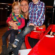 NLD/Amsterdam/20111123 - Boekpresentatie Maureen du Toit ' Altijd & overal feest', Selma van Dijk met dochter Noor en zoon Gijs