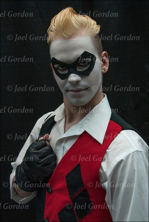 Cosplay attendee in his Harley Quinn gender switched costume.<br /> <br /> The New York Comic Con convention, is a celebration of comic books, graphic novels, sci-fi and video games, toys, movies and television.<br /> <br /> More than 130,000 people attended the event dressed up as their favorite superhero to celebrate comic books, sci-fi and video games.<br /> <br /> The convention brings together celebrities as well as fans of fantasy role playing, Comic-Con is the business of pop culture.