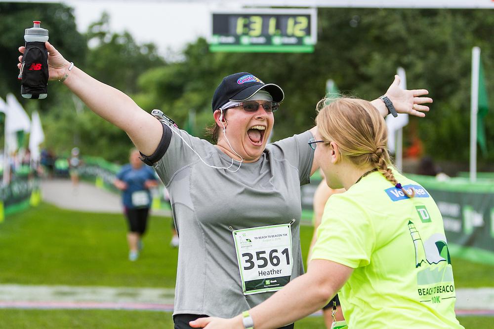 happy runners cross finish line