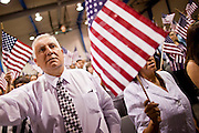 """July 2 - PHOENIX, AZ: MICHEL CHERGUI, originally from France, becomes a US citizen during a naturalization ceremony Friday. Nearly 200 people were sworn in as US citizens during the """"Fiesta of Independence"""" at South Mountain Community College in Phoenix, AZ, Friday. The ceremony is an annual event on th 4th of July weekend and usually the largest naturalization ceremony of the year in the Phoenix area.  Photo by Jack Kurtz"""