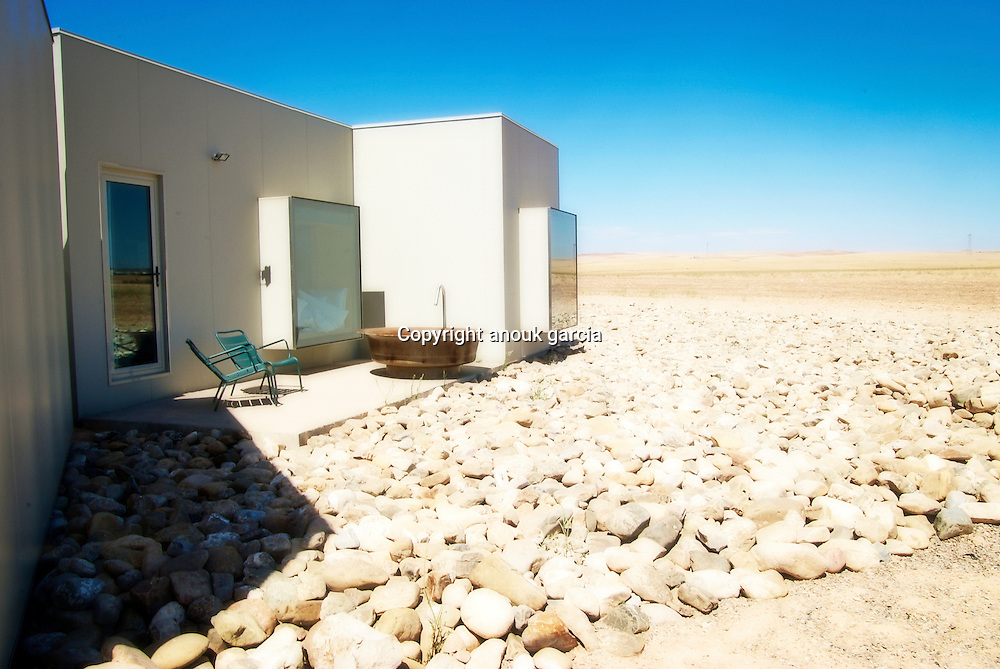 The Hotel Aire de Bardenas (airedebardenas.com) blends into its surroundings, inviting guests to.immerse themselves in the lunar landscape via vast window seats. Named after the local wind, it was.built with recycled materials where possible and a brief to limit its impact on the environment.