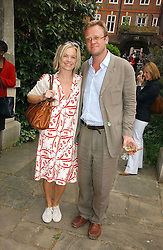 MARIELLA FROSTRUP and her husband JASON McCUE at the annual Macmillan Cancer Support House of Lords vs the House of Commons Tug of War held in Victoria Tower Gardens on 20th June 2006.<br />