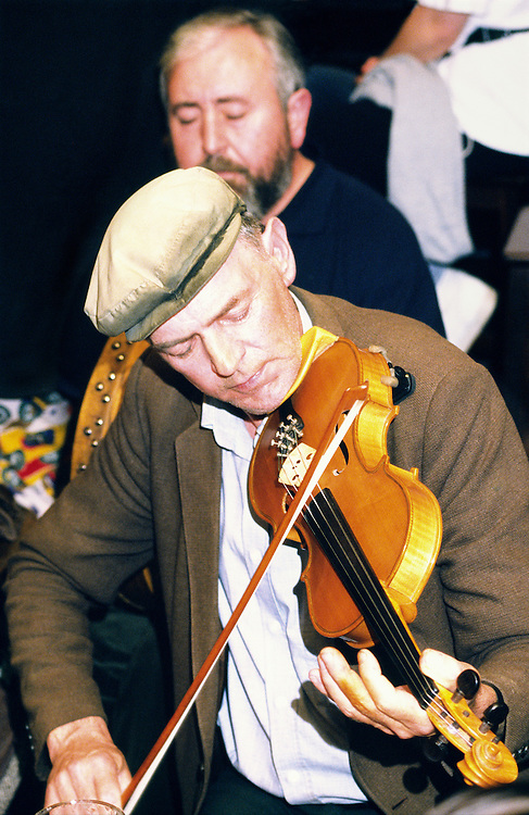 Traditional Irish pub music session in Days Bar on County Galway island of Inishbofin. Des O'Halloran, singer and fiddle player.