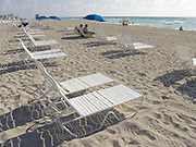 relaxing in a chairs on the beach Miami USA
