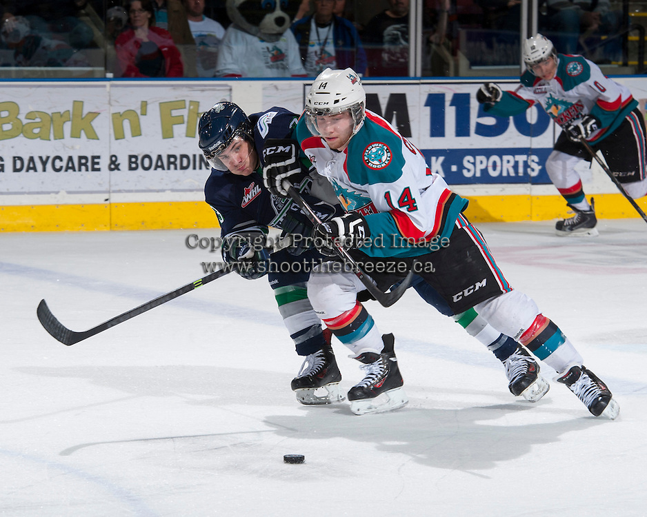 KELOWNA, CANADA - APRIL 3: Mathew Barzal #13 of the Seattle Thunderbirds is checked by Rourke Chartier #14 of the Kelowna Rockets on April 3, 2014 during Game 1 of the second round of WHL Playoffs at Prospera Place in Kelowna, British Columbia, Canada.   (Photo by Marissa Baecker/Getty Images)  *** Local Caption *** Mathew Barzal; Rourke Chartier;