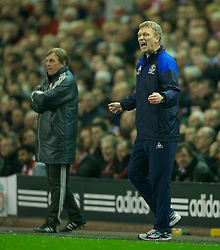LIVERPOOL, ENGLAND - Tuesday, March 13, 2012: Everton's manager David Moyes, on his 10th anniversary as the club's manager, and Liverpool's manager Kenny Dalglish during the Premiership match at Anfield. (Pic by David Rawcliffe/Propaganda)