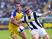 Chievo foward Sergio Pellissier and Giorgio Chiellini (face mask) during their Serie A football match Juventus versus Chievo at Olympic Stadium in Turin on April 5, 2009.