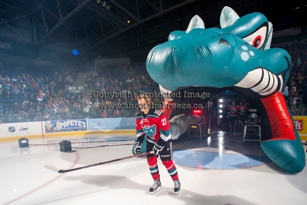 KELOWNA, CANADA - SEPTEMBER 21:  Ryan Olsen #27 of the Kelowna Rockets enters the ice during the regular season home opener against the Kamloops Blazers at the Kelowna Rockets on September 21, 2013 at Prospera Place in Kelowna, British Columbia, Canada (Photo by Marissa Baecker/Shoot the Breeze) *** Local Caption ***