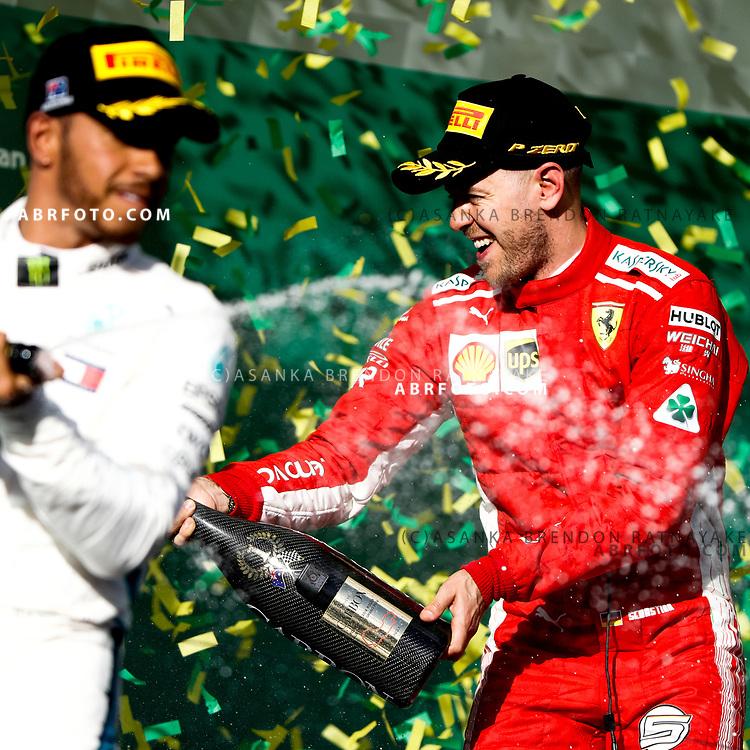 Race winner Ferrari driver Sebastian Vettel of Germany sprays champagne during the 2018 Rolex Formula 1 Australian Grand Prix at Albert Park, Melbourne, Australia, March 24, 2018.  Asanka Brendon Ratnayake
