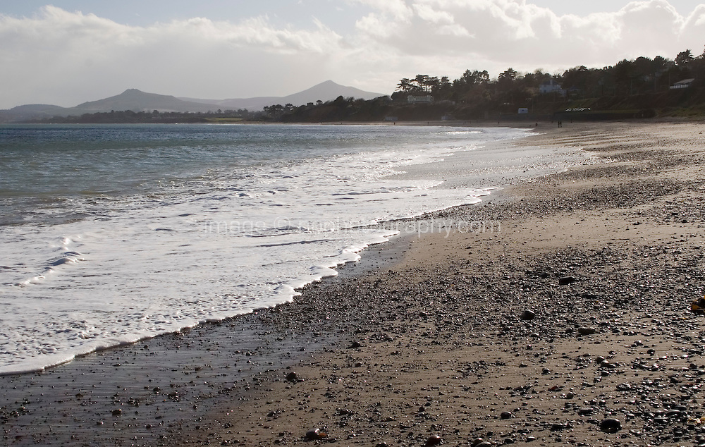 Winter sunlight on Killiney Beach in Dublin Ireland in the winter