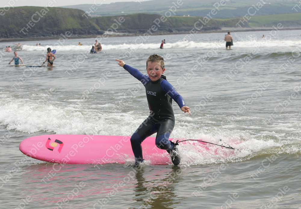 Tiernan McDermott, Clarecastle catching some waves with the John McCarthy Surf School on Lahinch beach. Pic Sean Curtin Press 22.