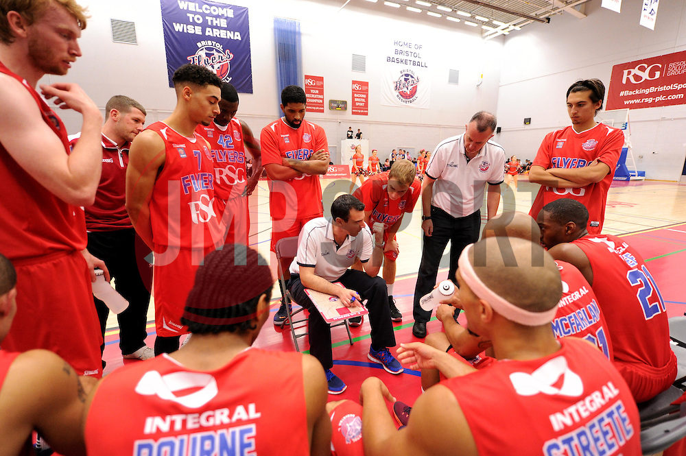 Andreas Kapoulas head coach of Bristol Flyers talk tactics with his players during a time out - Photo mandatory by-line: Paul Knight/JMP - Mobile: 07966 386802 - 10/10/2015 - BASKETBALL - SGS Wise Arena - Bristol, England - Bristol Flyers v Newcastle Eagles - British Basketball League