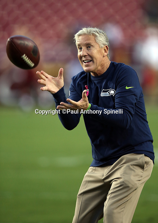 Seattle Seahawks head coach Pete Carroll smiles as he catches a pass before the NFL week 5 regular season football game against the Washington Redskins on Monday, Oct. 6, 2014 in Landover, Md. The Seahawks won the game 27-17. ©Paul Anthony Spinelli
