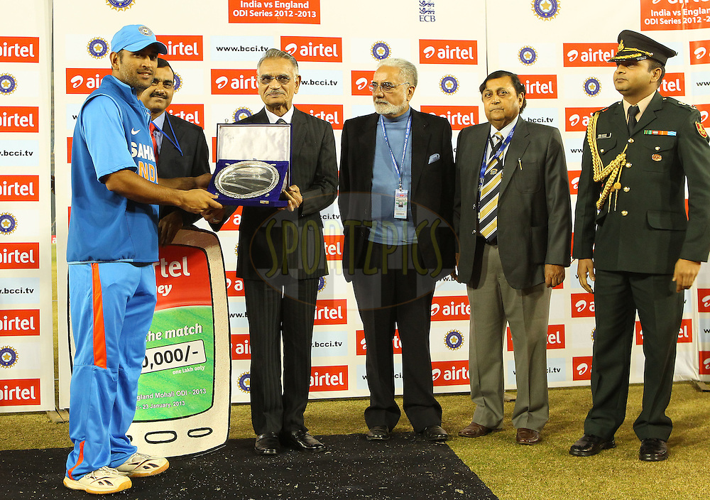 MS Dhoni of India  receives a silver plate during the 4th Airtel ODI Match between India and England held at the PCA Stadium, Mohal, India on the 23rd January 2013..Photo by Ron Gaunt/BCCI/SPORTZPICS ..Use of this image is subject to the terms and conditions as outlined by the BCCI. These terms can be found by following this link:..http://www.sportzpics.co.za/image/I0000SoRagM2cIEc