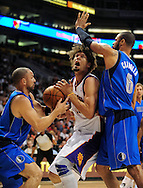 Feb. 17, 2011; Phoenix, AZ, USA; Phoenix Suns center Robin Lopez (15) is guarded by the Dallas Mavericks guard Jason Kidd (2) and teammate center Tyson Chandler (6) at the US Airways Center. Mandatory Credit: Jennifer Stewart-US PRESSWIRE