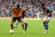 Dominic Iorfa attacks being held up by Jordan Amavi and Scott Sinclair during the Pre-Season Friendly match between Wolverhampton Wanderers and Aston Villa at Molineux, Wolverhampton, England on 28 July 2015. Photo by Alan Franklin.