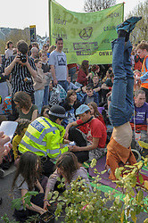 Members of Extinction Rebellion continue to protest on Waterloo Bridge, closing it to all traffic for the fourth day running. Police moved in again to take away activists from the group although for each person they arrested another immediately took their place. <br /> <br /> Richard Hancox | EEm