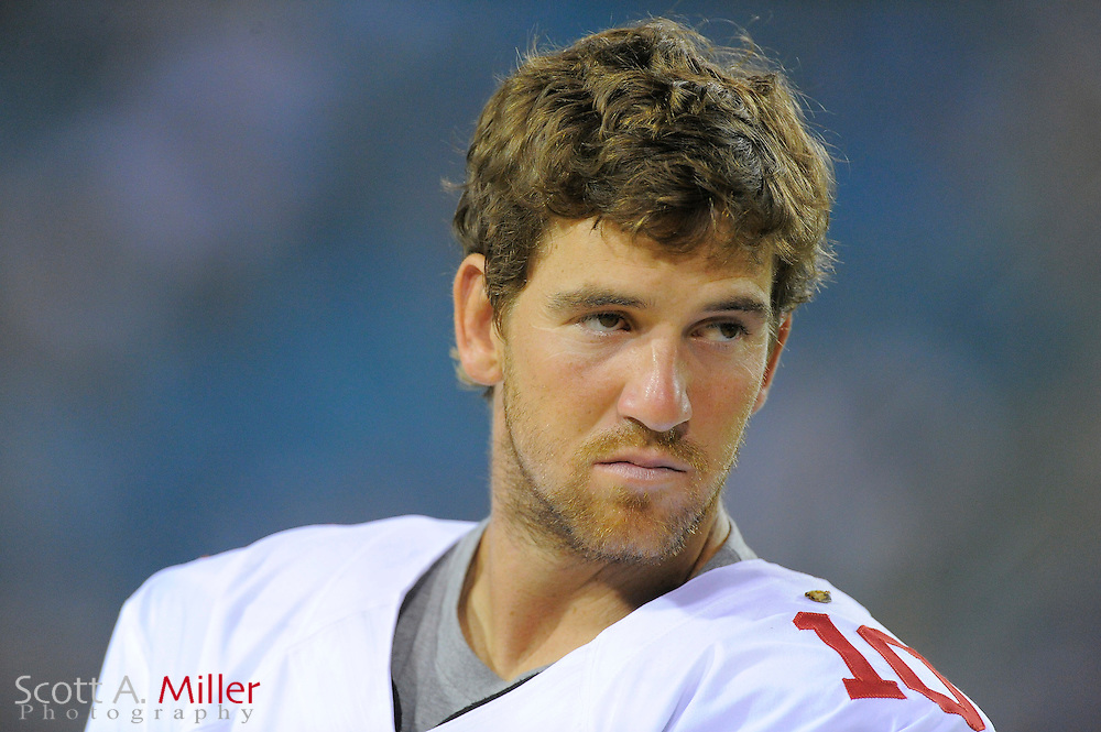New York Giants quarterback Eli Manning (10) on the sideline with his helmet off during the Giants NFL preseason game against the Jacksonville Jaguars at EverBank Field on August 10, 2012 in Jacksonville, Florida. ..©2012 Scott A. Miller..
