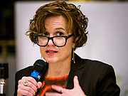 "18 APRIL 2017 - MINNEAPOLIS, MN: BETSY HODGES, mayor of Minneapolis, at a ""Town Hall"" style community meeting related to immigration at Incarnation Catholic Church in Minneapolis, MN. About 200 people attended the meeting. The meeting was hosted by Congressman Keith Ellison.     PHOTO BY JACK KURTZ"