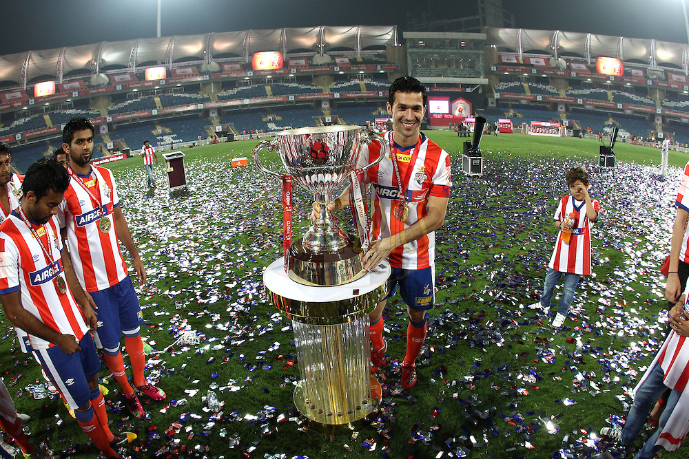 Luis Garcia of Atletico de Kolkata poses with the Trophy after Atletico de Kolkata beat Kerala Blasters FC to become ISL Champions during the final of the Hero Indian Super League between Kerala Blasters FC and Atletico de Kolkata held at the D.Y. Patil Stadium, Navi Mumbai, India on the 2oth December 2014.<br /> <br /> Photo by:  Shaun Roy / ISL/ SPORTZPICS