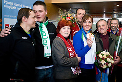 Slovenian bronze medalist cross-country skier Petra Majdic with her coach Ivan Hudac, brother Gasper (L), mother Vera, brother Gregor and father Peter at arrival to Airport Joze Pucnik from Vancouver after Winter Olympic games 2010, on March 1, 2010 in Brnik, Slovenia. (Photo by Vid Ponikvar / Sportida)