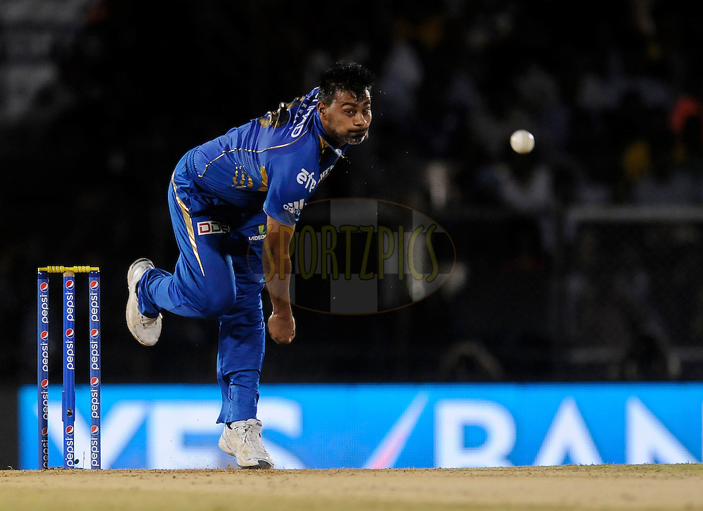 Praveen Kumar of Mumbai Indians bowls during the eliminator match of the Pepsi Indian Premier League Season 2014 between the Chennai Superkings and the Mumbai Indians held at the Brabourne Stadium, Mumbai, India on the 28th May  2014<br /> <br /> Photo by Pal PIllai / IPL / SPORTZPICS<br /> <br /> <br /> <br /> Image use subject to terms and conditions which can be found here:  http://sportzpics.photoshelter.com/gallery/Pepsi-IPL-Image-terms-and-conditions/G00004VW1IVJ.gB0/C0000TScjhBM6ikg