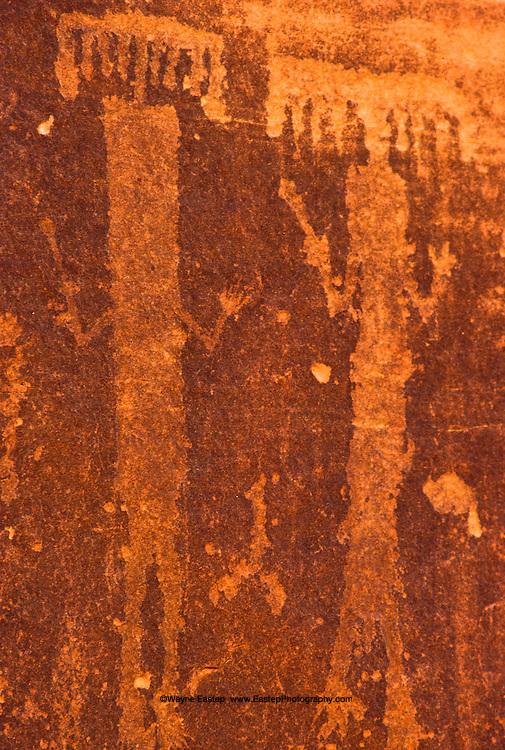 Incised style rock art representing a human dancing. Jebel Burnus, al Jouf, Saudi Arabia