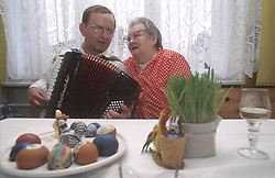 CZECH REPUBLIC MORAVIA BANOV APR98 - Accordeon player Jiri Chovanec plays a tune for an old woman in her home during the Easter Celebrations. jre/Photo by Jiri Rezac<br /> <br /> &copy; Jiri Rezac 1998<br /> <br /> Tel:   +44 (0) 7050 110 417<br /> Email: info@jirirezac.com<br /> Web:   www.jirirezac.com