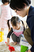 Children are playing in an indoor sandbox at Bridge for Fukushima, an NPO that are helping parents with young children in Minamisoma, 20 km from the nuclear power plant. Fuksuhima, Japan.