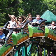 Young children enjoy a roller coaster ride during the Weston Fair, Weston, Connecticut, USA. 28th May 2012. Photo Tim Clayton