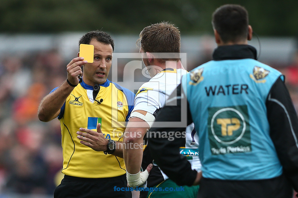 Referee Greg Garner shows a yellow card to Alex Waller of Northampton Saints (right) during the Aviva Premiership match at Allianz Park, London<br /> Picture by Andy Kearns/Focus Images Ltd 0781 864 4264<br /> 17/09/2016