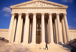 Lone man walking down the stairs at the US Supreme Court House in Washington, DC