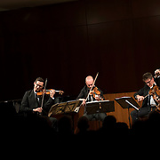 """February 22, 2015 - New York, NY : From left, The Calder Quartet's Ben Jacobson (violin), Andrew Bulbrook (violin), Jonathan Moerschel (viola), and Eric Byers (cello) perform at the Brooklyn Public Library, Central Library as part of Carnegie Hall's """"Neighborhood Concert"""" series on Sunday afternoon. CREDIT: Karsten Moran for The New York Times"""