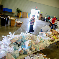 Tables overflow with grocery bundles packaged by Family, Career & Community Leaders of America volunteers at the First Baptist Church in Grants Thursday.
