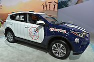 Toyota RAV4 Hybrid custom painted in NY Yankees baseball team theme is on display at the New York International Auto Show 2016, at the Jacob Javits Center. The blue, white and red car had white with blue pinstripes, and the Yankees emblem. This was Press Preview Day one of NYIAS, and the car Trade Show will be open to the public for ten days, March 25th through April 3rd.