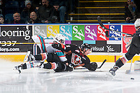 KELOWNA, CANADA - FEBRUARY 6: Dillon Dube #19 of Kelowna Rockets checks a player of the Calgary Hitmen to the ice on February 6, 2016 at Prospera Place in Kelowna, British Columbia, Canada.  (Photo by Marissa Baecker/Shoot the Breeze)  *** Local Caption *** Dillon Dube;