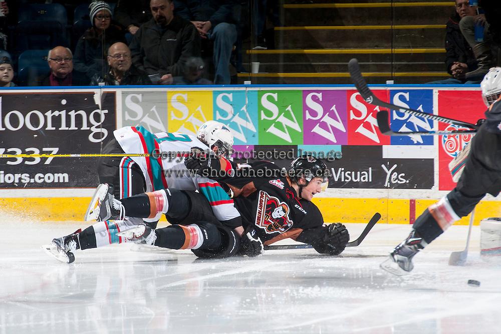KELOWNA, CANADA - FEBRUARY 6: Dillon Dube #19 of Kelowna Rockets checks a player of the Calgary Hitmen to the ice on February 6, 2016 at Prospera Place in Kelowna, British Columbia, Canada.  (Photo by Marissa Baecker/Shoot the Breeze)  *** Local Caption *** Dillon Dube;