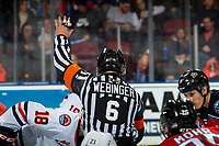 KELOWNA, BC - NOVEMBER 16:  Referee Kevin Webinger stands at the face-off and drops the puck between the Kelowna Rockets and the Kamloops Blazers at Prospera Place on November 16, 2019 in Kelowna, Canada. (Photo by Marissa Baecker/Shoot the Breeze)